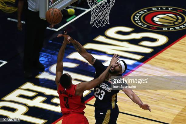 New Orleans Pelicans forward Anthony Davis blocks the shot against Portland Trail Blazers guard CJ McCollum during the game between the New Orleans...