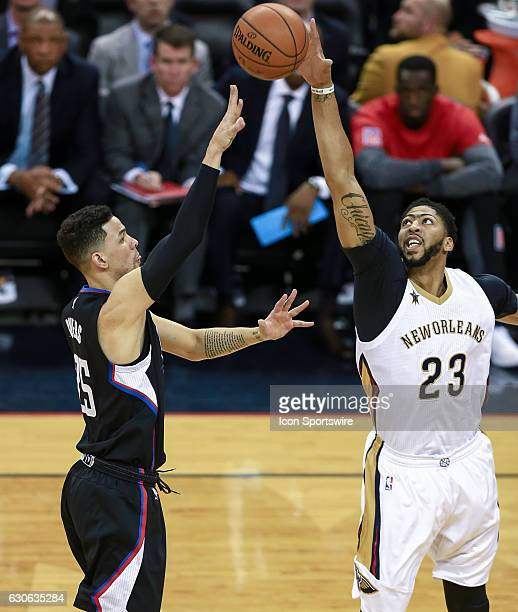 New Orleans Pelicans forward Anthony Davis blocks the shot of LA Clippers guard Austin Rivers during the game between the New Orleans Pelicans and...