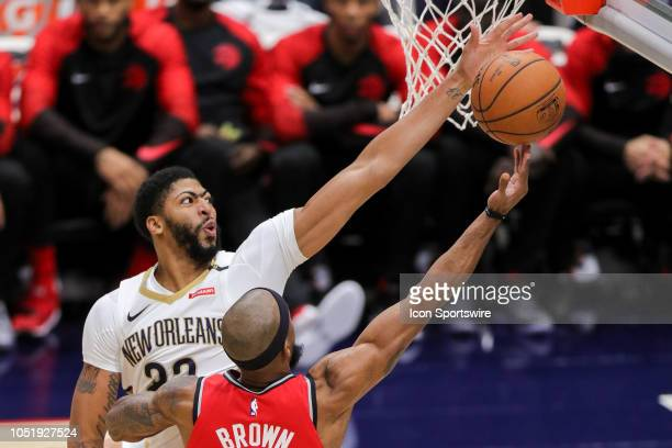 New Orleans Pelicans forward Anthony Davis blocks the shot of Toronto Raptors guard Lorenzo Brown on October 11 2018 at Smoothie King Center in New...