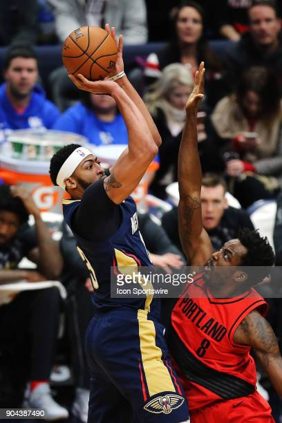 New Orleans Pelicans forward Anthony Davis drives to the basket against Portland Trail Blazers forward AlFarouq Aminu during the game between the New...
