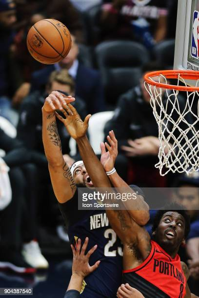New Orleans Pelicans forward Anthony Davis has the ball blocked against Portland Trail Blazers forward AlFarouq Aminu during the game between the New...