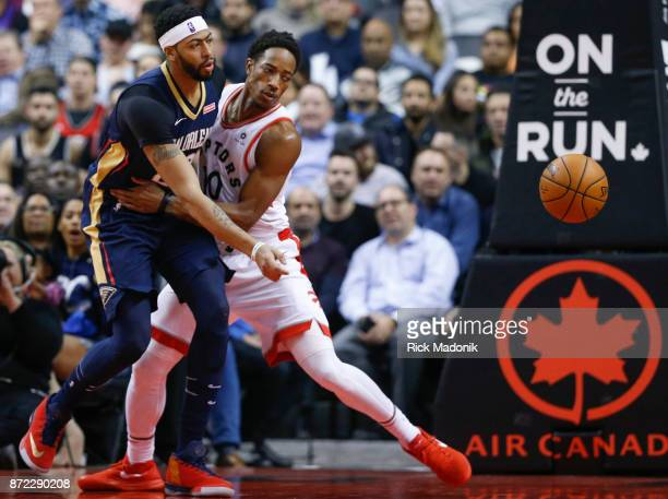 New Orleans Pelicans forward Anthony Davis is guarded by Toronto Raptors guard DeMar DeRozan Toronto Raptors vs New Orleans Pelicans in 1st half...
