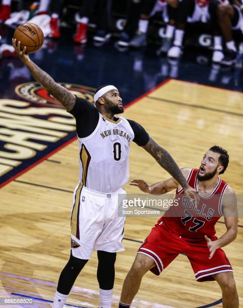 New Orleans Pelicans forward DeMarcus Cousins catches a pass against Chicago Bulls center Joffrey Lauvergne during the game between the New Orleans...