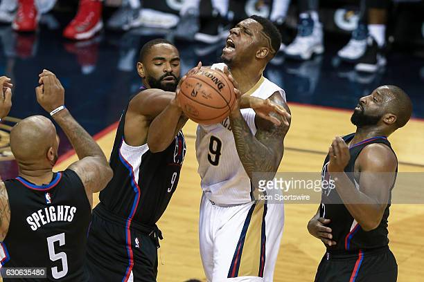 New Orleans Pelicans forward Terrence Jones is fouled by LA Clippers guard Alan Anderson during the game between the New Orleans Pelicans and the LA...