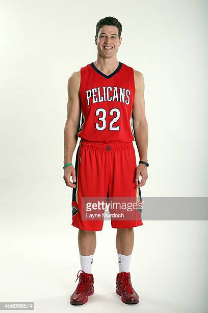 New Orleans Pelicans Jimmer Fredette poses in the new Pelican Alternative uniform for a press conference and Junior Training Camp on September 23...