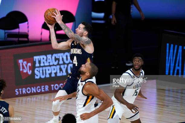 New Orleans Pelicans' JJ Redick shoots over Utah Jazz's Rudy Gobert and Emmanuel Mudiay right during the second half of an NBA basketball game on...