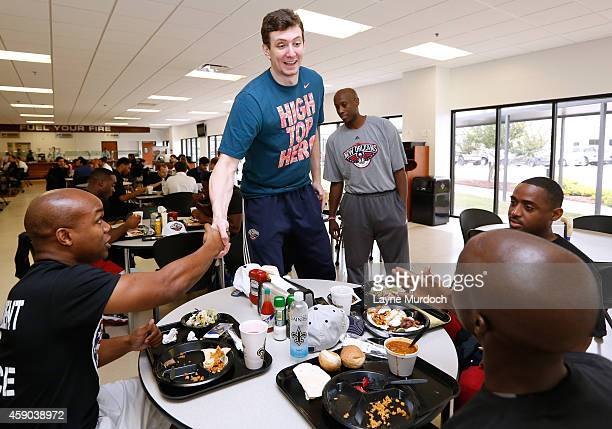 New Orleans Pelicans Omer Asik along with players and coaches host 20 local marines in celebration of NBA Hoops for Troops Week at their practice on...
