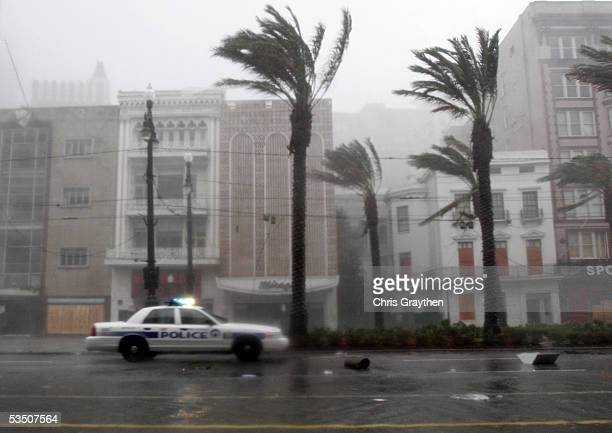 New Orleans Police car drives down Canal Street during Hurricane Katrina early in the morning August 29 2005 in New Orleans Louisiana Katrina made...
