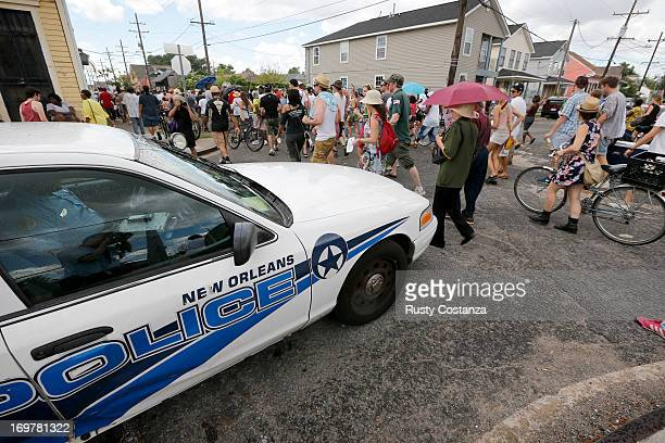 New Orleans Police Department cruiser sits at the intersection of North Villere and Pauger Streets as members of the Original Big Seven Social Aid...