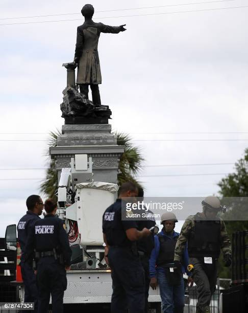 New Orleans police officers stand guard at the Jefferson Davis monument on May 4 2017 in New Orleans Loiusiana The Louisiana House committee on...