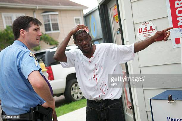 DAVIS New Orleans Police Sgt James Young assists on a call of a man beaten in a robbery ay Key's Food Store as they patrol the Garden District in New...