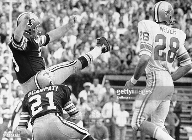 Record Kick Saints field goal expert Tom Dempsey watches one of his kicks split the uprights during first half action here Nov 8th as safety Joe...