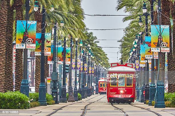 new orleans red streetcars,louisiana - new orleans stock pictures, royalty-free photos & images