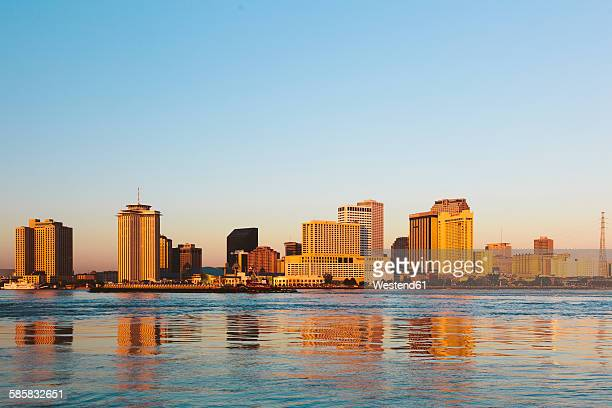 USA, New Orleans reflected in the Mississippi river at sunrise