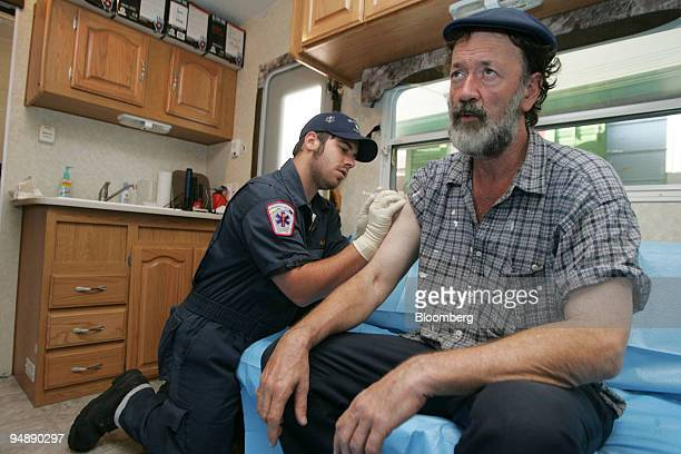 New Orleans resident Royce Bufkin gets his tetanus and hepatitis A and B shots Tuesday September 13 2005 from Alex Bumpus owner of BiCounty Ambulance...