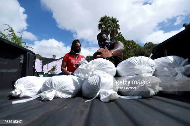 New Orleans residents fill sandbags in preparation for Hurricane Laura on August 25, 2020 in New Orleans, Louisiana. Hurricane Laura is expected to...