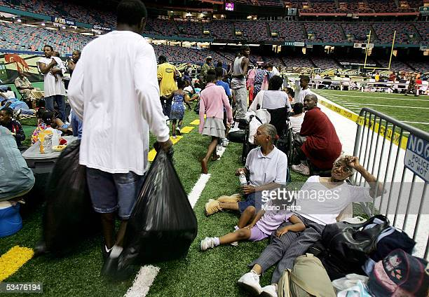 New Orleans residents sit in the Superdome which is being used as an emergency shelter before the arrival of Hurricane Katrina August 28 2005 in New...