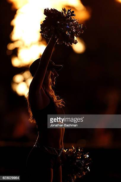 New Orleans Saints cheerleader performs before a game against the Denver Broncos at the MercedesBenz Superdome on November 13 2016 in New Orleans...