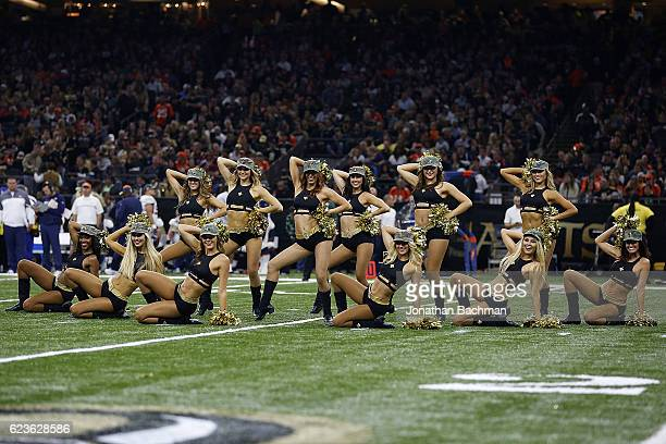 New Orleans Saints cheerleader performs during a game against the Denver Broncos at the MercedesBenz Superdome on November 13 2016 in New Orleans...