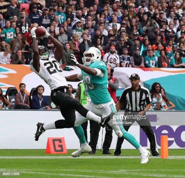 New Orleans Saints cornerback Ken Crawley catches an interception during the NFL match between the Miami Dolphins and the New Orleans Saints at...