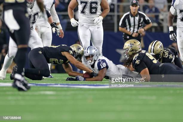 New Orleans Saints Cornerback Marshon Lattimore forces a Dallas Cowboys Wide Receiver Amari Cooper fumble during the game between the Dallas Cowboys...