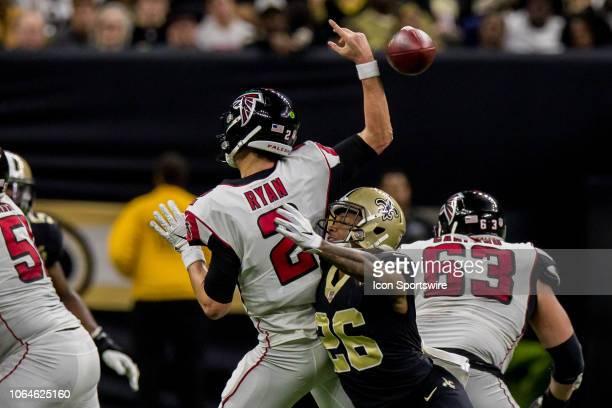 New Orleans Saints cornerback PJ Williams hits Atlanta Falcons quarterback Matt Ryan causing a fumble on November 22 2018 at the MercedesBenz...