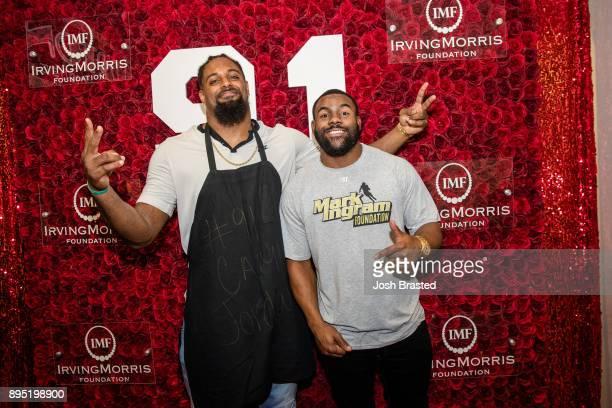 New Orleans Saints defensive end Cam Jordan and running back Mark Ingram attend the Cam Jordan Celebrity Server Event benefiting the Irving Morris...