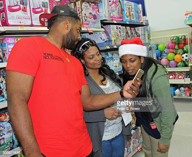 New Orleans Saints defensive end Cameron Jordan shows off an item he helped to look up for some shoppers at Walmart Supercenter on December 8 2015 in...