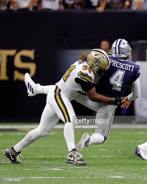 New Orleans Saints defensive end Cameron Jordan tackles Dallas Cowboys quarterback Dak Prescott as he releases the ball during the game between the...
