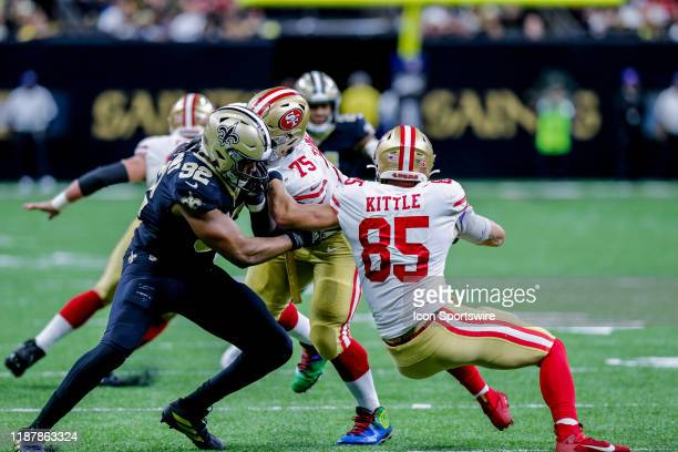 New Orleans Saints defensive end Marcus Davenport tackles San Francisco 49ers tight end George Kittle on December 8 2019 at the MercedesBenz...
