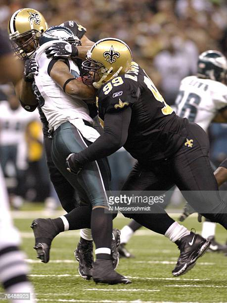 New Orleans Saints defensive tackle Hollis Thomas stops Philadelphia Eagles running back Brian Westbrook in an NFL secondround playoff game on...