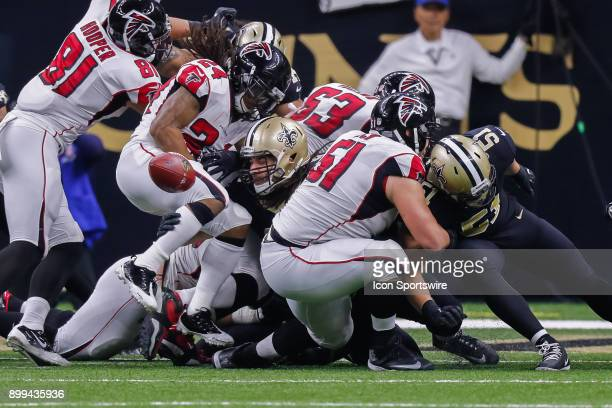 New Orleans Saints defensive tackle Tyeler Davison pops the ball loose from Atlanta Falcons running back Devonta Freeman while middle linebacker...