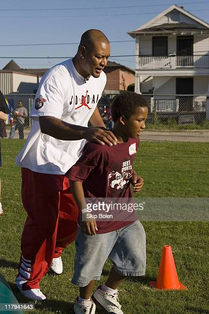 New Orleans Saints Deuce McAllister participating in football drills with local kids ages 616 as part of the Best Damn Sports Clinic in Taylor Park...