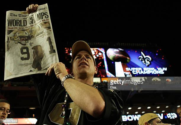 New Orleans Saints fan holds up a paper celebrating the Saints win after defeating the Indianapolis Colts during Super Bowl XLIV on February 7 2010...