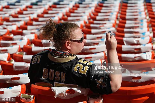 New Orleans Saints fan Reagan Booth takes a photo prior to the start of Super Bowl XLIV between the Indianapolis Colts and the New Orleans Saints on...