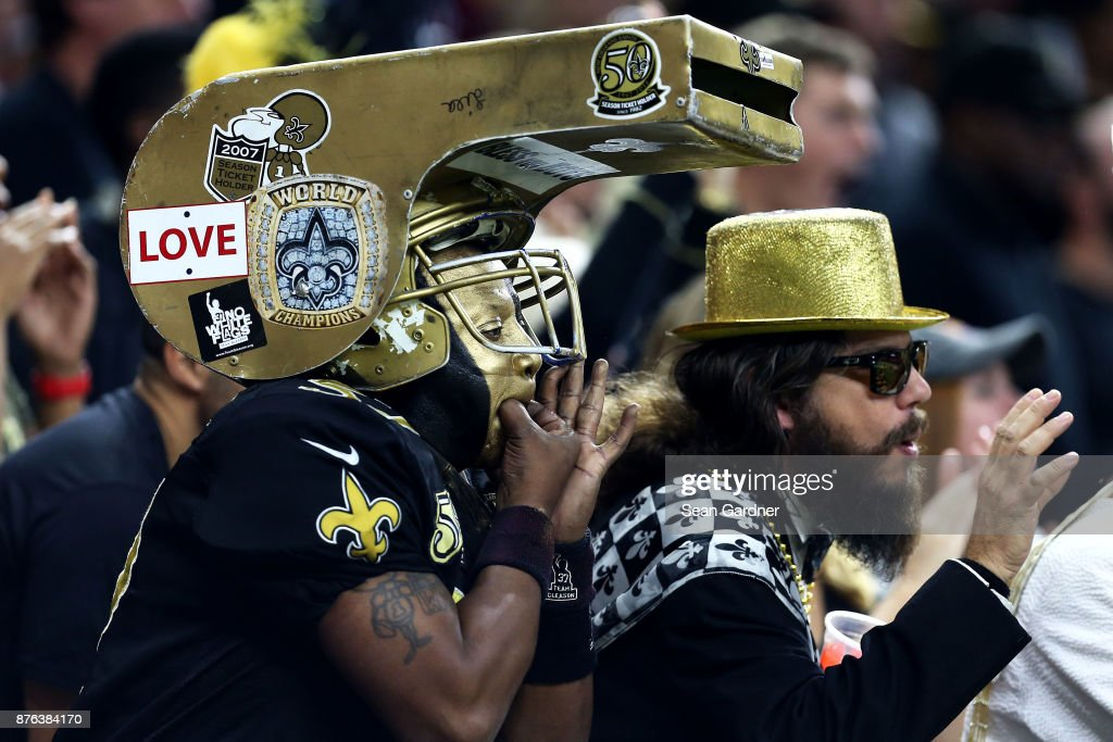 New Orleans Saints fans cheer for their team as they play the Washington Redskins during the first half at the Mercedes-Benz Superdome on November 19, 2017 in New Orleans, Louisiana.