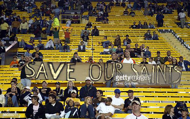 "New Orleans Saints fans hold up a sign which reads ""Save our Saints"" during the Miami Dolphins game on October 30, 2005 at Tiger Stadium on the..."