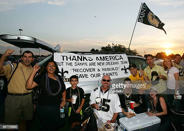 New Orleans Saints fans pose in the parking lot before the start of their team's game against the New York Giants on September 19, 2005 at Giants...