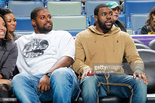 New Orleans Saints football players Cameron Jordan and Mark Ingram attend the game between the New Orleans Hornets and the Oklahoma City Thunder on...