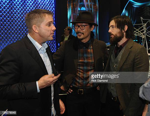 New Orleans Saints Head Coach Sean Payton and The Avett Brothers attend the 2011 CMT Artists of the year celebration at the Bridgestone Arena on...