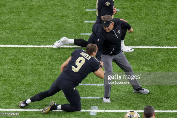 New Orleans Saints head coach Sean Payton shakes hands with quarterback Drew Brees before the game against Washington Redskins on November 19 2017 at...