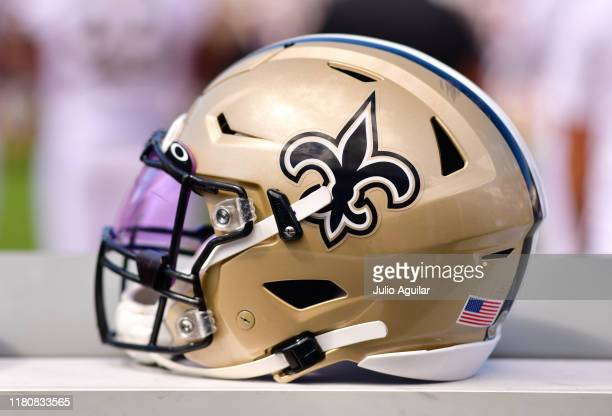 New Orleans Saints helmet is seen on the bench during the game between the New Orleans Saints and the Jacksonville Jaguars at TIAA Bank Field on...