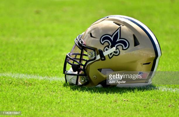 New Orleans Saints helmet is seen on the field before the game between the New Orleans Saints and the Jacksonville Jaguars at TIAA Bank Field on...