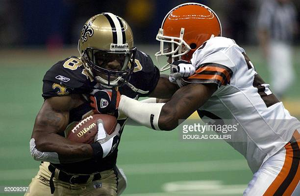 New Orleans Saints' Joe Horn gets hit by Cleveland Browns' Corey Fuller after making a first down in the first quarter 24 November 2002 at the...
