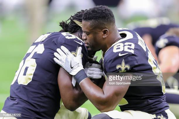 New Orleans Saints linebacker Demario Davis and tight end Benjamin Watson take a moment together before the game against Tampa Bay Buccaneers on...
