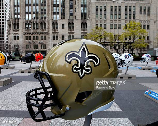 New Orleans Saints NFL football helmet is on display in Pioneer Court to commemorate the NFL Draft 2015 in Chicago on April 30 2015 in Chicago...