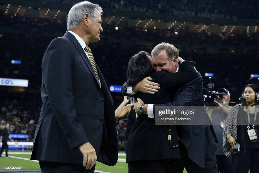 New Orleans Saints owner Gayle Benson, general manager Mickey Loomis and president Dennis Lauscha react as former owner Tom Benson is inducted into the Ring of Honor during a game at the Mercedes-Benz Superdome on September 9, 2018 in New Orleans, Louisiana.