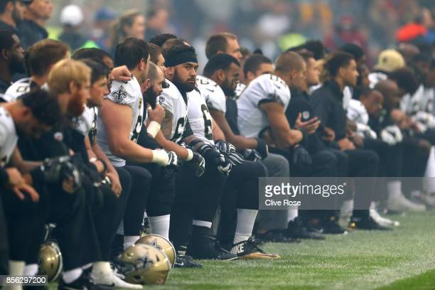 New Orleans Saints players and team kneel prior to the NFL match between New Orleans Saints andMiami Dolphins at Wembley Stadium on October 1 2017...