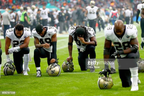 New Orleans Saints players and team kneel prior to the NFL match between New Orleans Saints and Miami Dolphins at Wembley Stadium on October 1 2017...