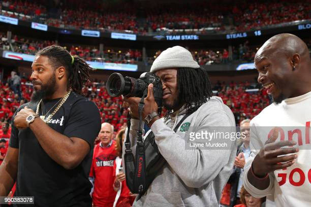 New Orleans Saints players Cameron Jordan Alvin Kamara and Chris Banjo attend Game Three of Round One between the Portland Trail Blazers and the New...